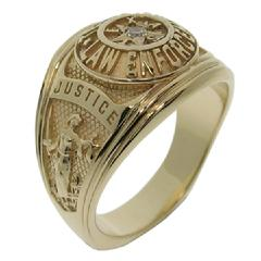Our Texas Law Enforcement class-style ring shown in 14k yellow gold with center set gemstone.